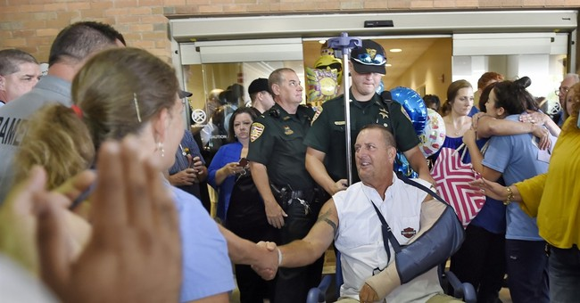 The Latest: Corporal recalls moments before officer slaying