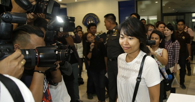 Thai police question British writer's wife over royal photos