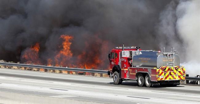 The Latest: Burned body found at California fire scene