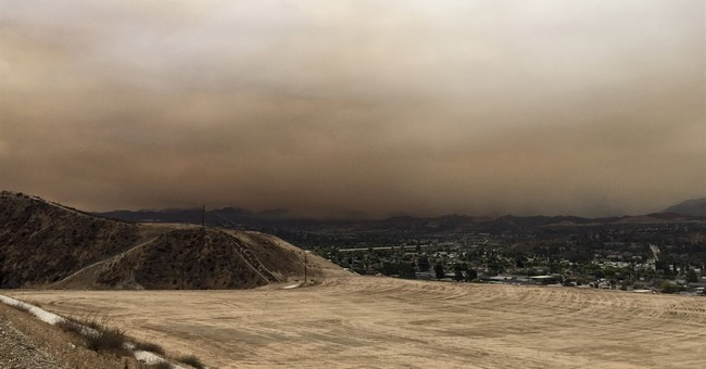 Burned body found as wildfire burns near Los Angeles