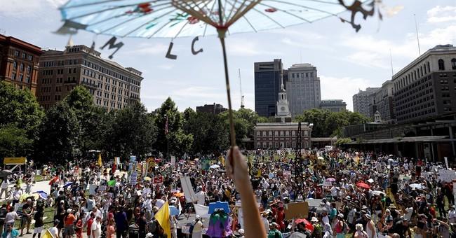 The Latest: Hollywood stars hold climate rally ahead of DNC