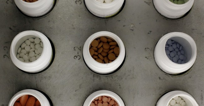AP Exclusive: Pricey drugs overwhelm Medicare safeguard