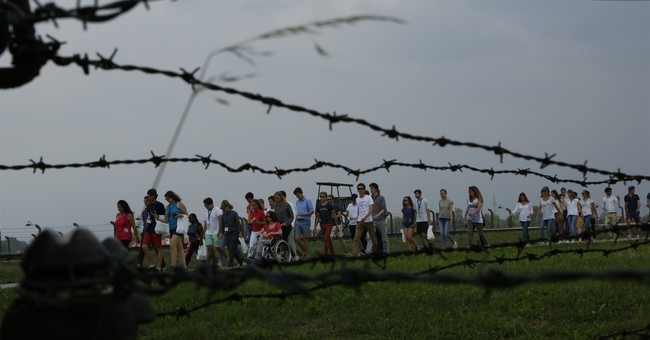 Catholic pilgrims visit Auschwitz ahead of visit by pope