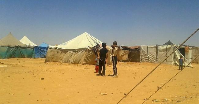 Cranes ready to drop aid into Syrian camps await Jordan nod