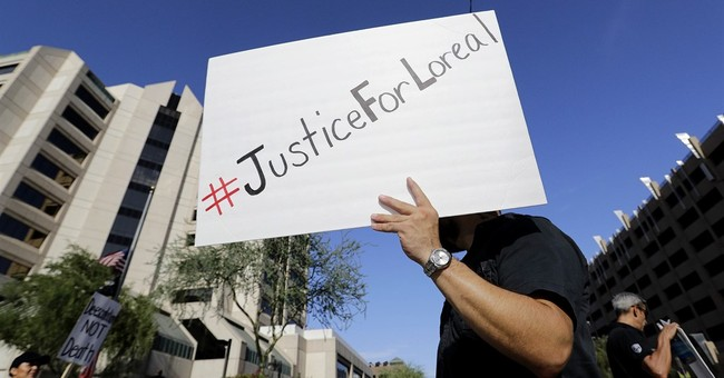 Activists protest no charges for Arizona officer in shooting