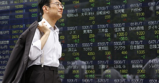 Global stocks mixed as investors eye corporate earnings
