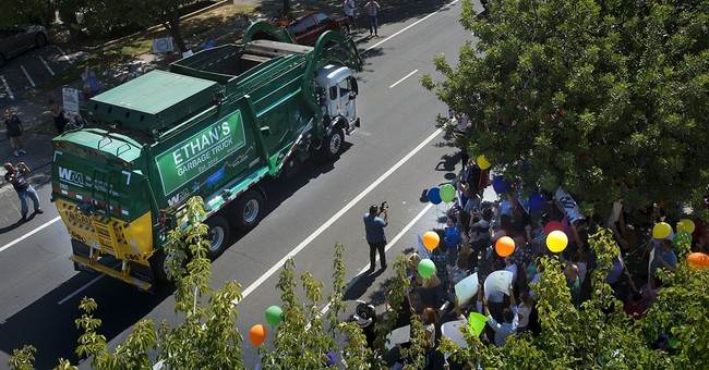 The Latest: Wish granted: Six-year-old boy is garbage man
