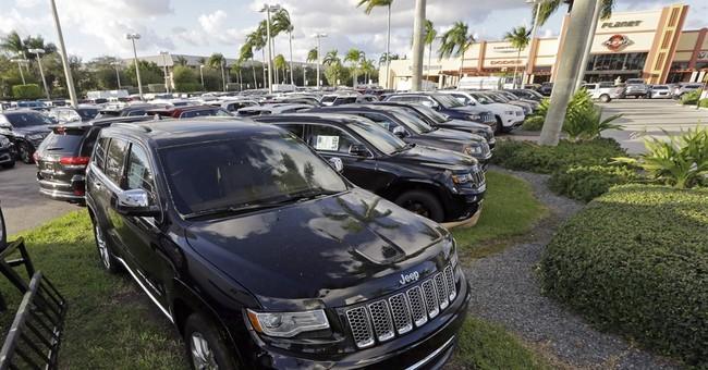 Fiat Chrysler revises sales, shows streak ended in 2013
