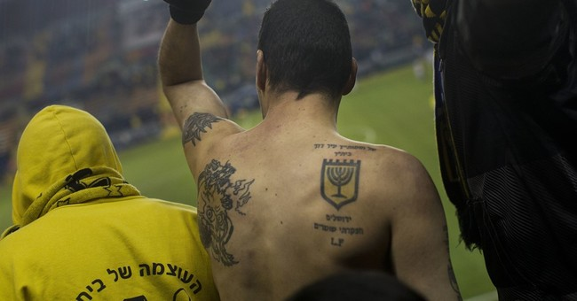 Israel police raid arrests dozens of extremist soccer fans