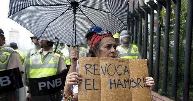 Venezuelan opposition seats lawmakers in challenge to Maduro