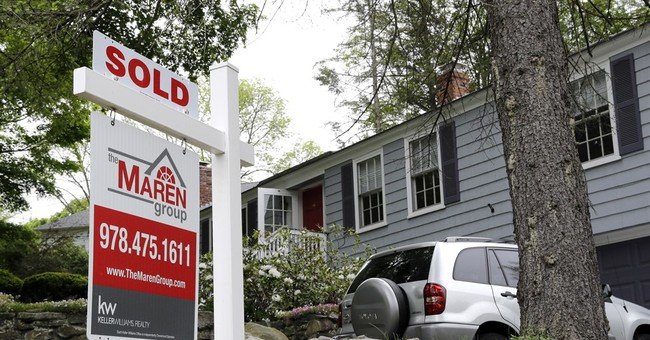Pending US home sales improved slightly in June