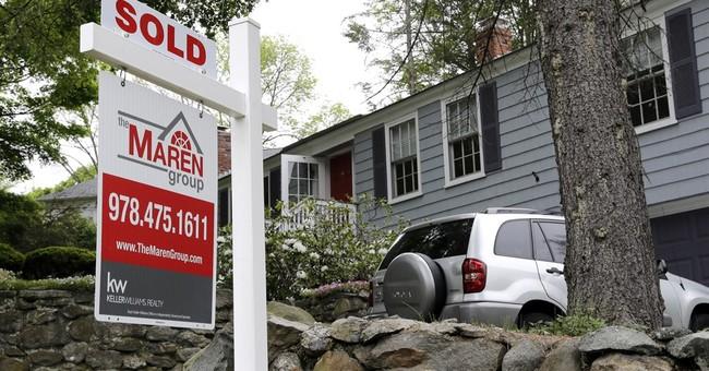 Pending US home sales improved slightly in June