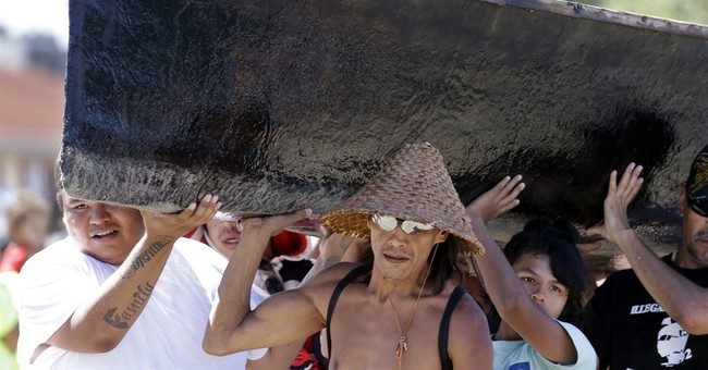 Tribal canoes arrive at Seattle beach in annual celebration
