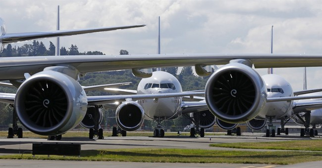 Boeing posts rare quarterly loss, mulls phasing out 747