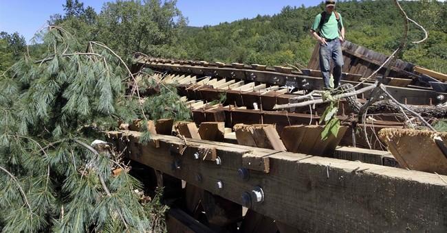 Covered bridge remains buried despite neighbors' wishes