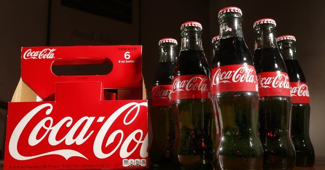 Coca-Cola cuts sales outlook amid weak international demand