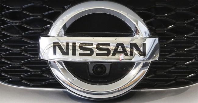 Nissan quarterly profit down 11 pct on yen, shrinking sales