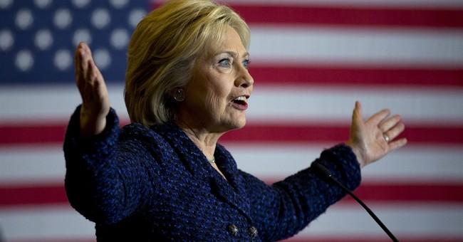 Clinton TV ads hammer guns in NH, shy away in Iowa