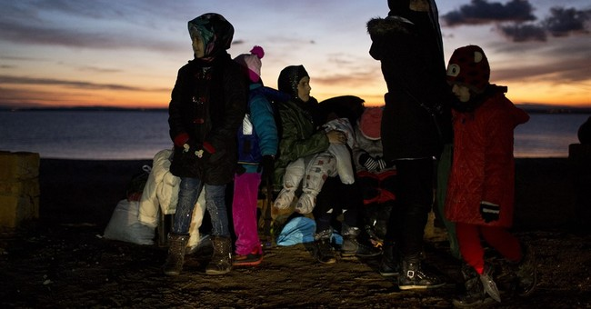 The Latest: Macedonia shuts border with Greece to refugees