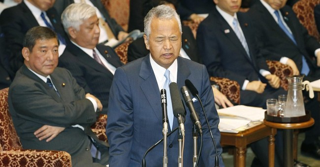 Japan's economy minister grilled over report he took bribes