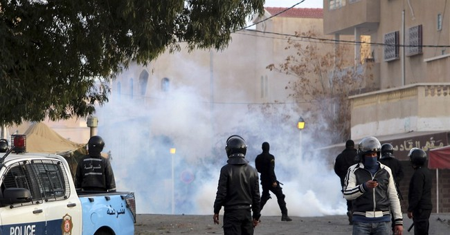 Tunisian officer killed as unrest over joblessness spreads