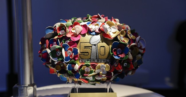 Fashion designers, NFL team up on 50 footballs for charity
