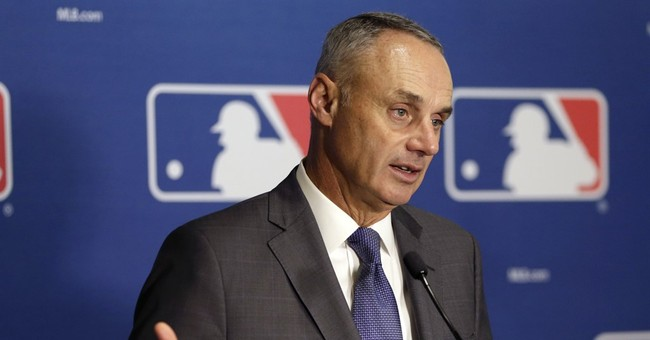MLB commissioner says NL teams may be more receptive to DH