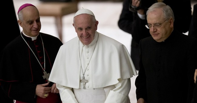 Pope changes church rules, opens foot-washing rite to women