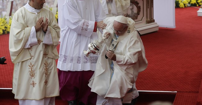 Pope Francis misses step, falls down before Mass in Poland