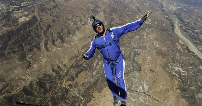 He's a skydiver working with a net _ but no parachute