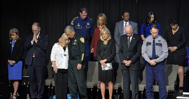 At vigil, Biden tries to comfort relatives of slain officers