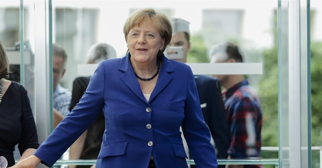 Merkel: Germany 'will manage' challenge after attacks