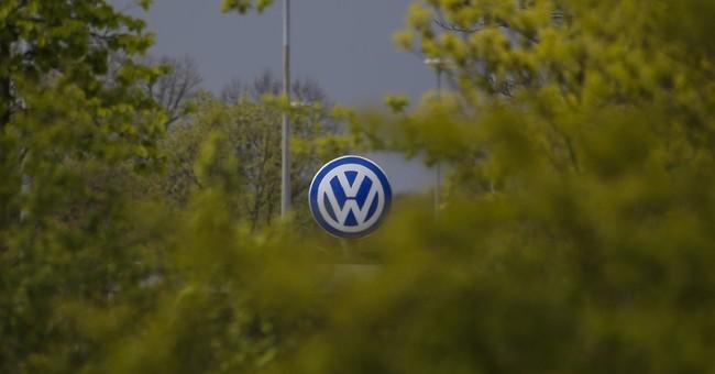 VW sees second quarter profit halved after emissions scandal
