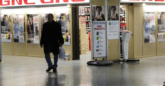 GNC CEO steps down, guidance suspended, shares plunge