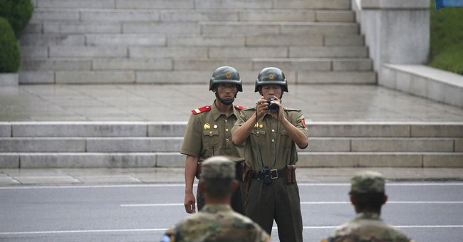 Lapel pins with images of ex-NKorean ruler found in South