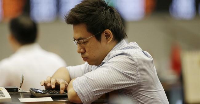 Stocks hesitate as investors work through earnings