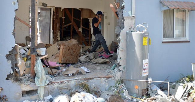 Driver accused of crashing into Los Angeles home surrenders