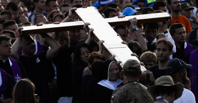 The Latest: Pope Francis: 'cruelty did not end in Auschwitz'