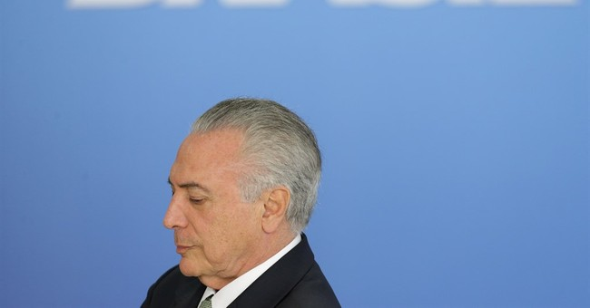 """Brazil's acting president """"ready"""" for jeers at Rio Olympics"""