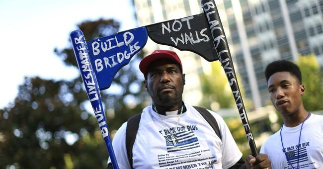 Dozens march in Dallas against police violence toward blacks