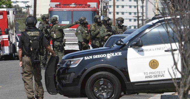 The Latest: Wounded San Diego officer alert after shooting