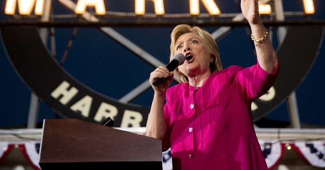 Clinton roars against Trump as a hacking distraction arises