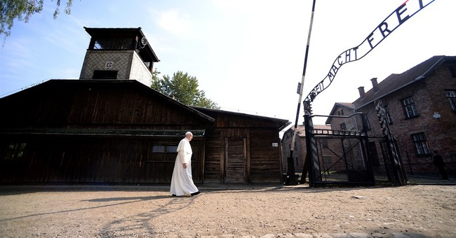 """Pope visits Auschwitz, begs God to forgive """"so much cruelty"""""""