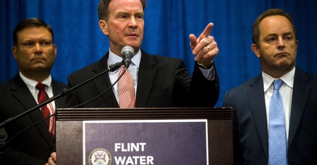 The Latest: Workers charged in Flint water crisis suspended