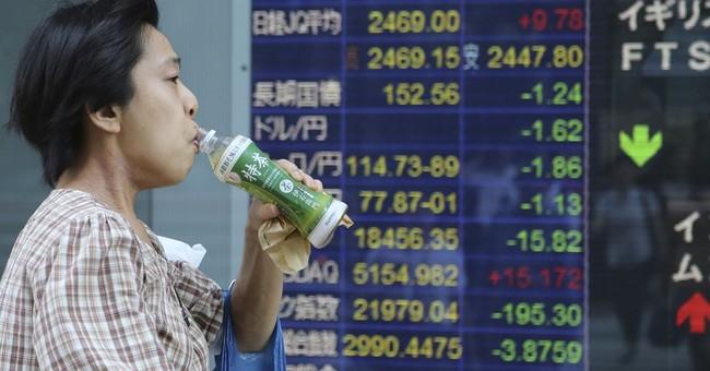 Markets subdued by BoJ's modest stimulus but yen surges
