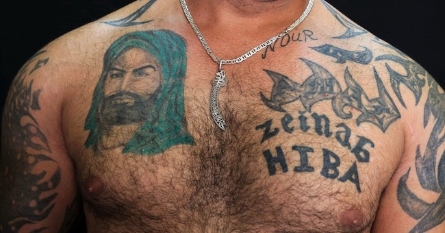 AP PHOTOS: Shiite tattoos a show of pride amid tensions