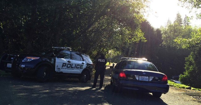 The Latest: Suspect in Seattle-area shooting booked