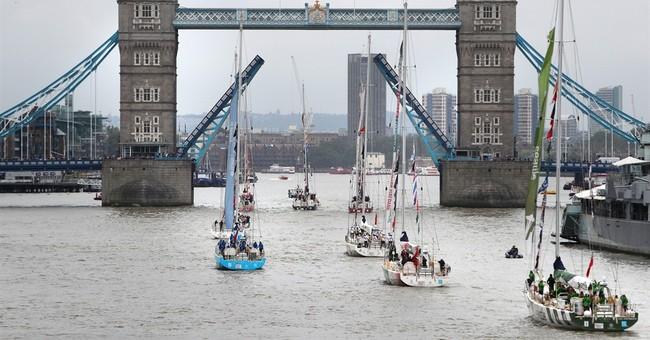 Yachts pass London's Tower Bridge after race around world