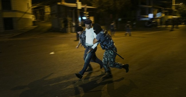 Armenian police accuse barricaded gunmen of killing officer