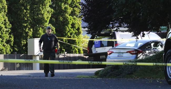 The Latest: Vigils held for Washington shooting victims